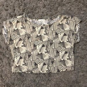 Black and white patterned blouse.